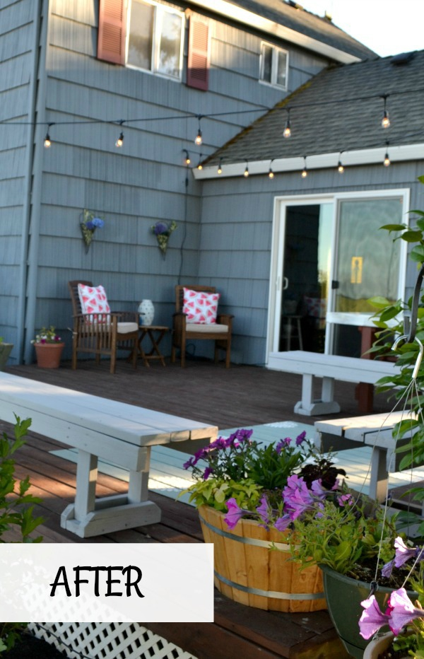 Outdoor living space updated with new deck stain, painted benches and painted rug