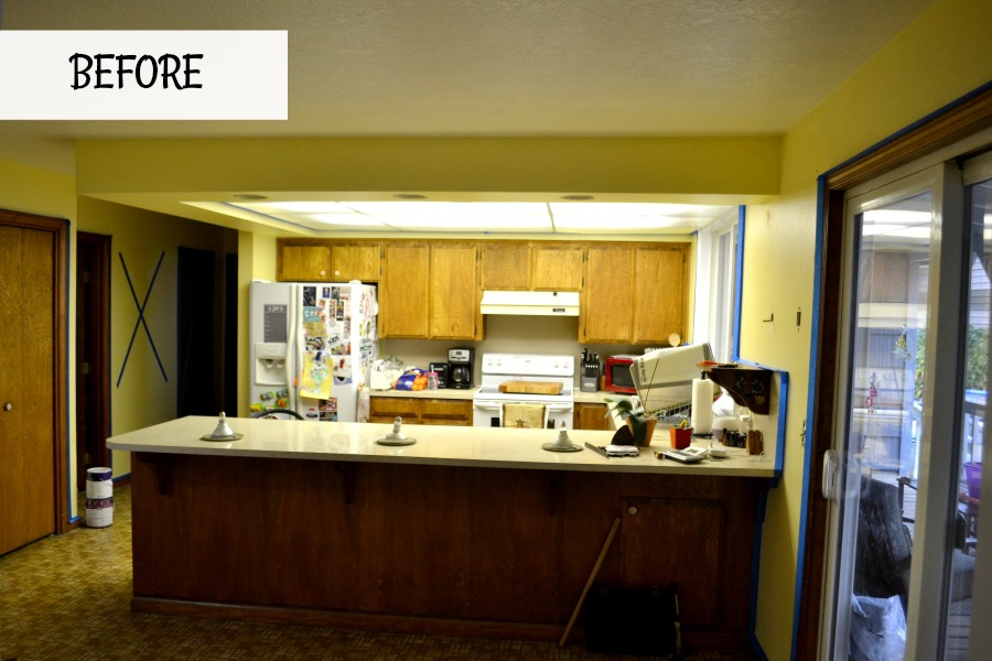 Outdated 1980s kitchen is updated with painted cabinets