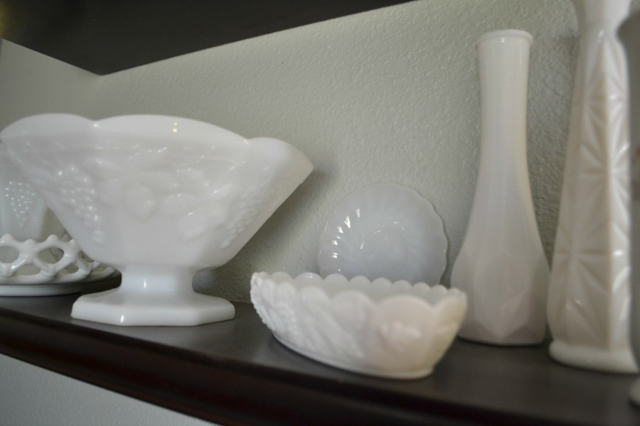 Milk glass collection displayed on open shelving