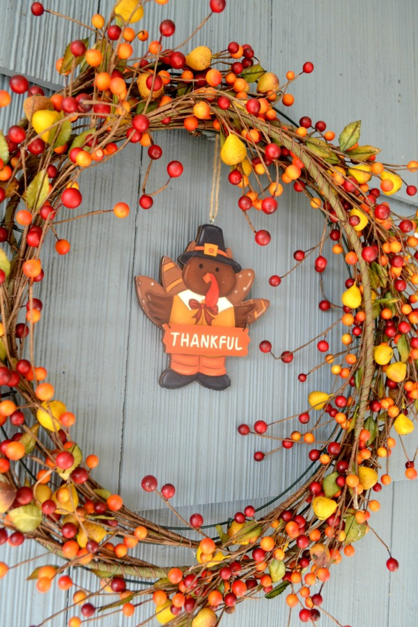 Fall wreath made from garland found at a garage sale and wreath ring
