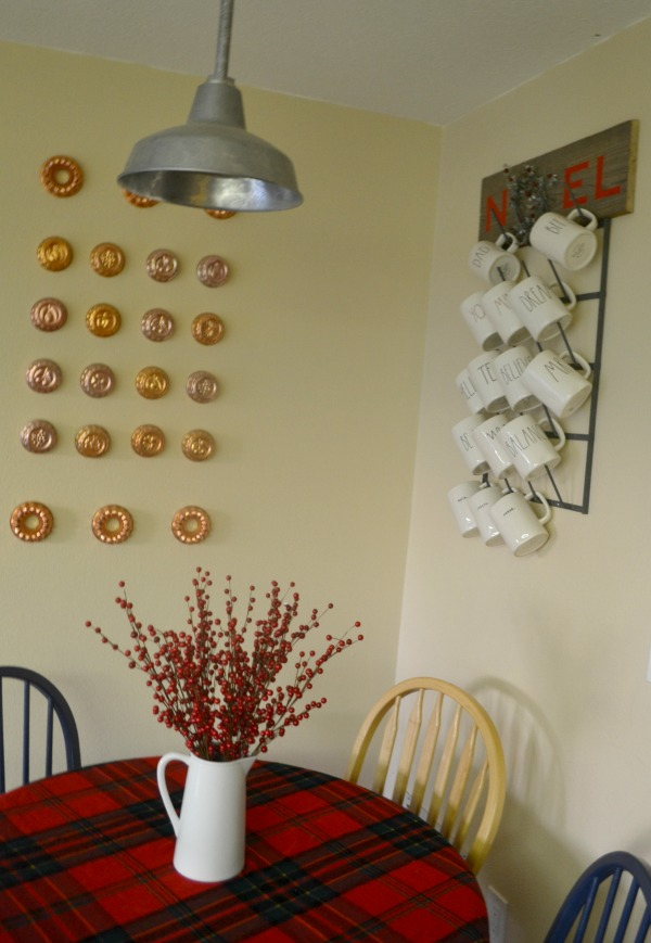 A rustic DIY noel wreath sign adds some holiday cheer to the breakfast nook