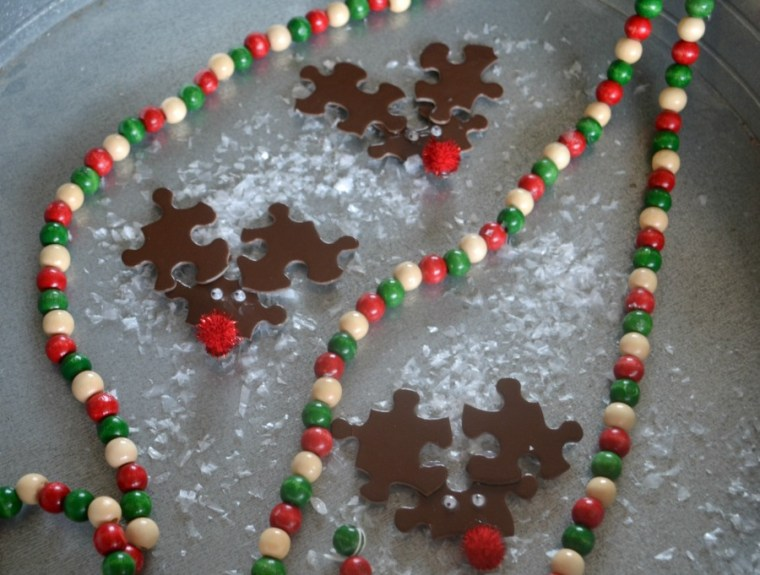 Puzzle piece reindeer made into magnets
