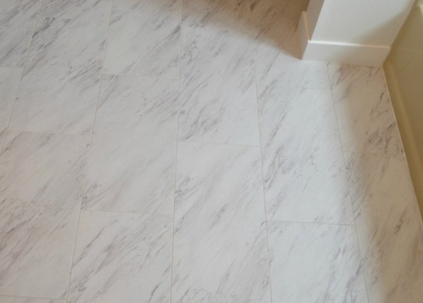 Stick on carerra marble flooring from Home Depot