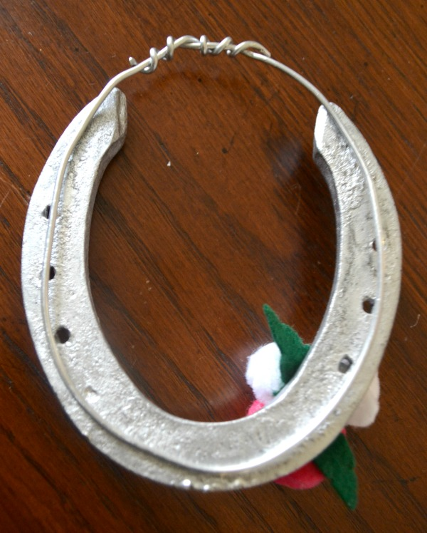 Heavy gauge wire is attached to the back of the horseshoes to create a sturdy hanger