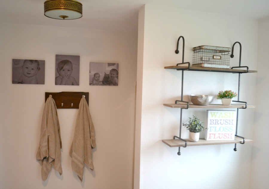 New shelving and towel hooks add so much to the bathroom update