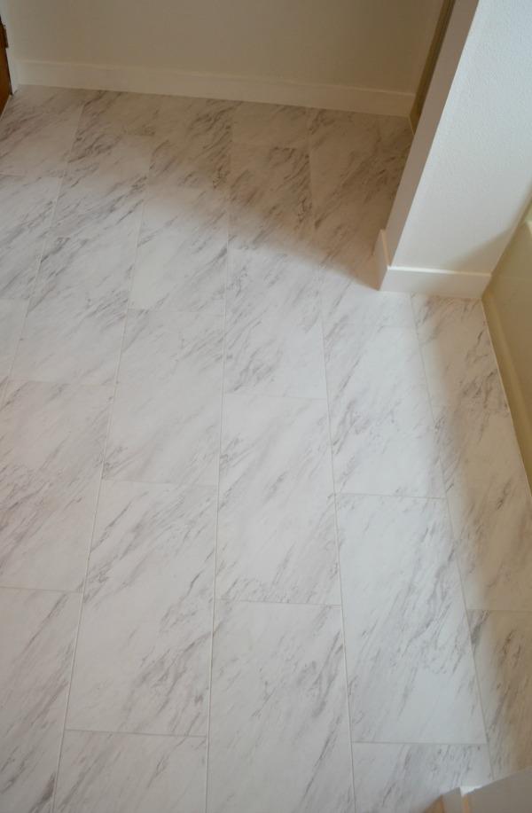 Finished vinyl tile peel and stick flooring