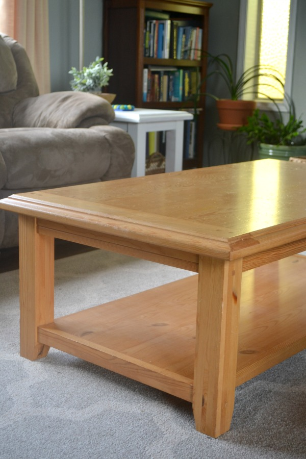 A not so pretty but functional coffee table is transformed into a farmhouse table with milk paint