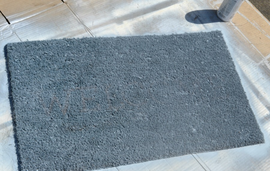 Light gray welcome mat that has now been spray painted