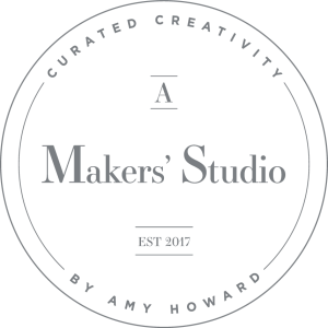 A round logo with A Maker's Studio in the center