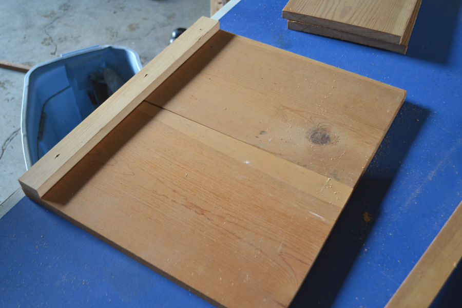 Wood boards with bracing on the side on a blue table