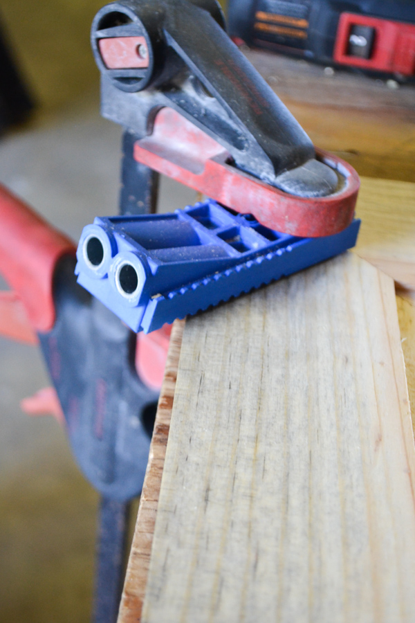 A jig clamped onto a wood frame
