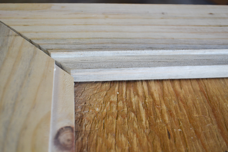 Routered edges of wood cut at a 45 degree angle at a close up