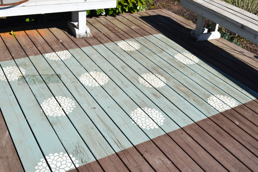 A far off shot of a painted deck rug in need of cleaning