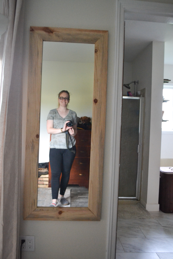 A picture of a woman in a mirror holding a camera