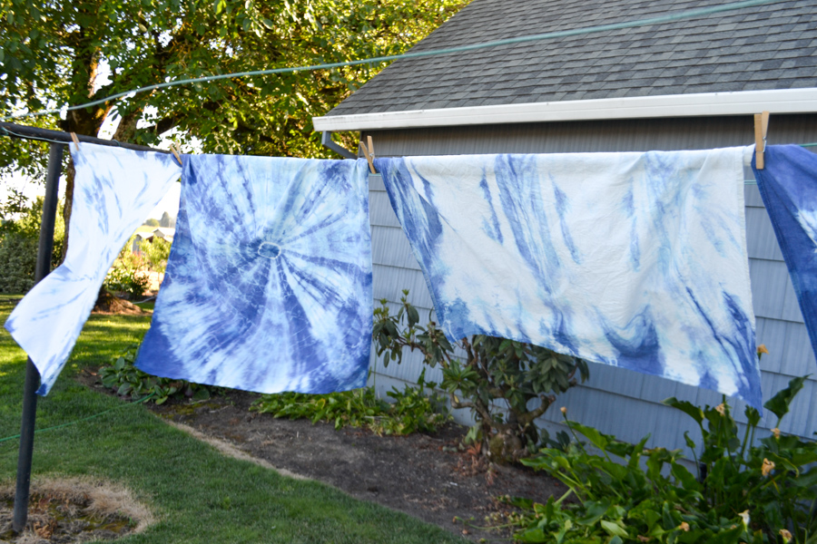 Shibori tie dyed linen towels on a clothesline outside