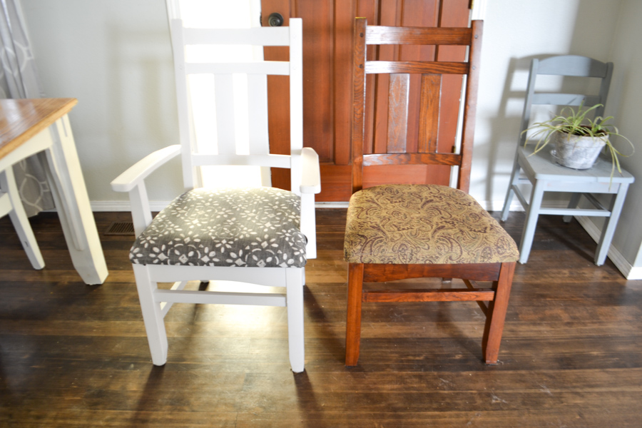 Two dining chairs sitting side by side, one painted white with a blue and white fabric seat and the other brown with a brown damask patterned fabric seat