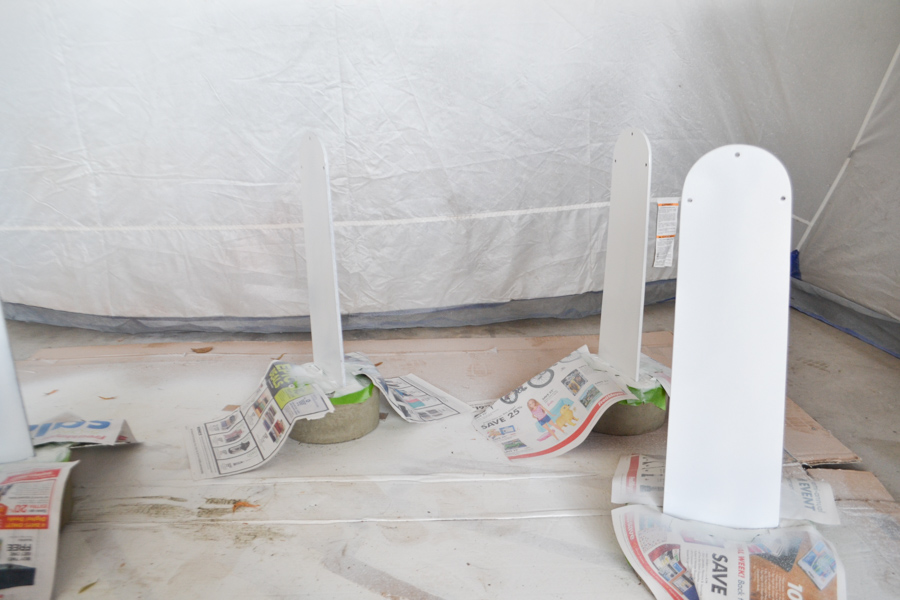 Fan blades in concrete covered with newspaper painted white