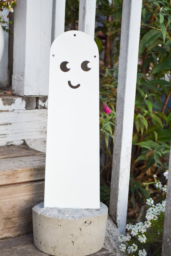 A white fan blade in concrete with a cute ghost face