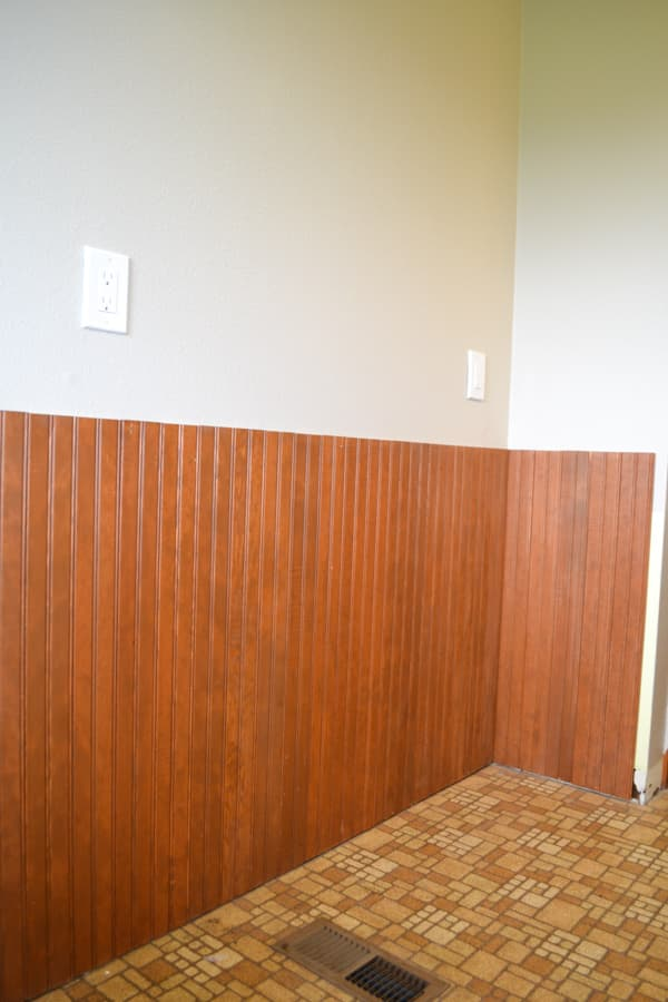 A close up of brown wainscotting installed on a wall