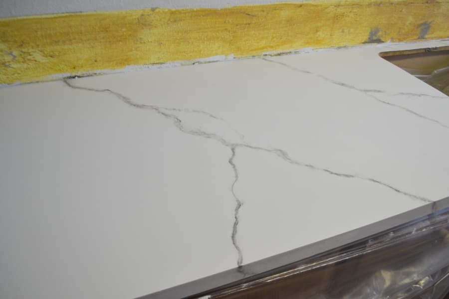 A close up of large gray veins on a white painted countertop
