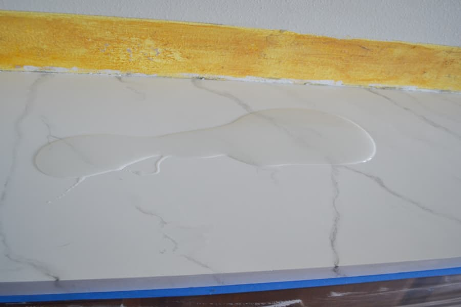 A painted marble countertop with an epoxy poured overtop in a puddle