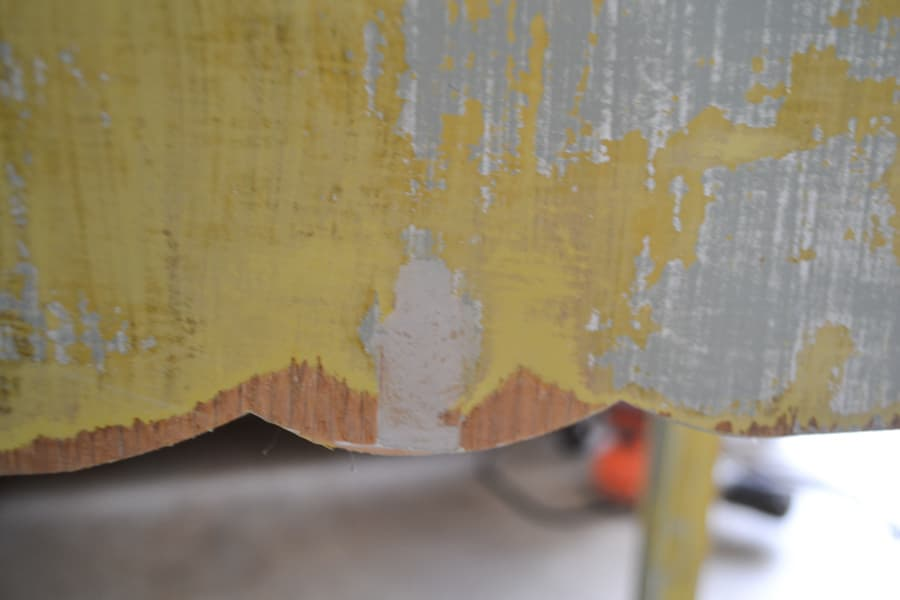 A close up of a putty area on a sewing table side