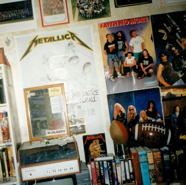 Bedroom wall with Metallica, Faith No More, etc. posters