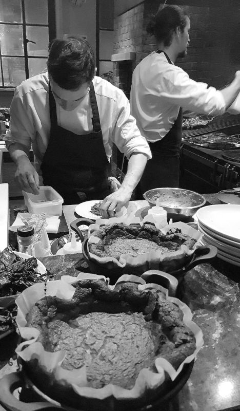 Review of Brat restaurant London, where diners can seamlessly view the chefs preparing the food