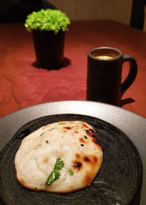 Indian Accent has a signature starter of blue cheese naan, served up with a creamy sweet pumpkin and coconut shorba