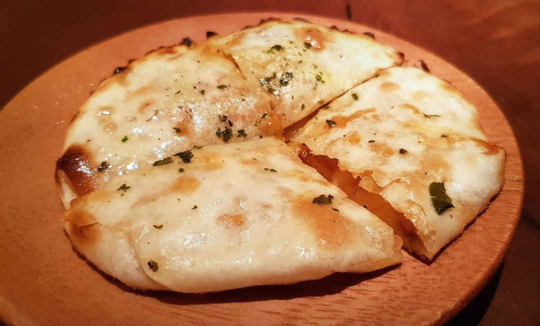 Indian Accent serves up some astoundingly good breads, including this butter chicken kulcha