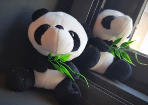 Panda mascot on the windowsill at North London restaurant that specialises in Chinese cuisine.