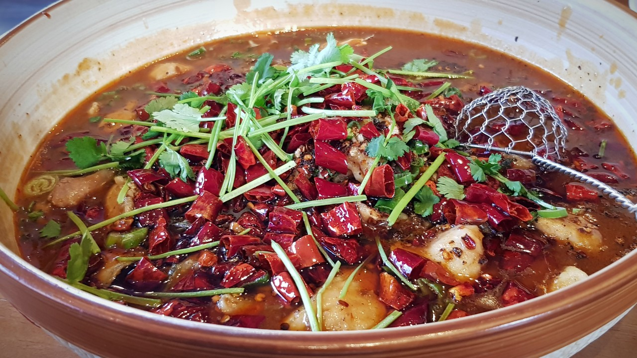 A dish of sea bass in Kaki London comes in a rich spicy broth of chilli and Sichuan pepper.