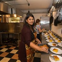 Shahnaz Ahsan author and cook in the kitchen of her Tiger Kitchen supperclub preparing dishes from her Bangladesh heritage