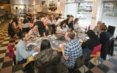 Bengali supperclub taking place in a dining hall in London
