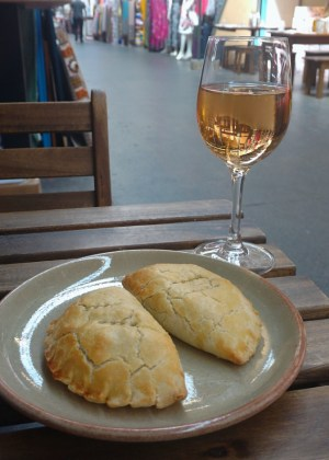 Nigerian meat pies and a glass of wine in Tooting Market