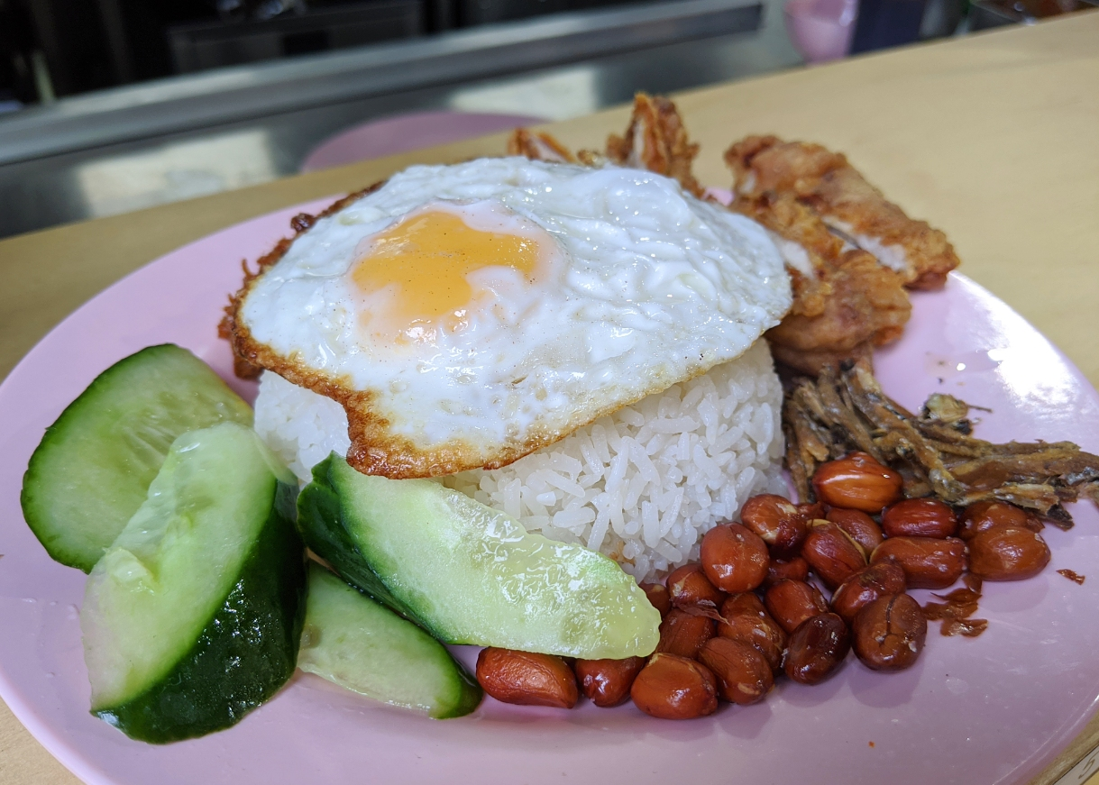 Nasi lemak at Mei Mei London - a Singaporean dish of fried chicken, fried egg, rice, cucumber, peanuts and anchovy.