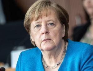 Merkel, Covid-19 aşılarının fikri mülkiyet hakları konusunda Uğur Şahin'le görüştü