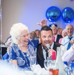 Simon with lady in blue dress