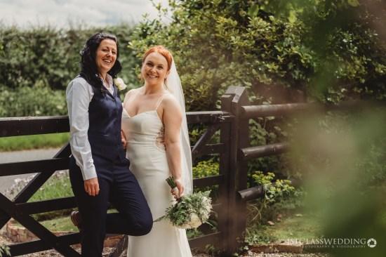 two brides at curradine barns wedding venue