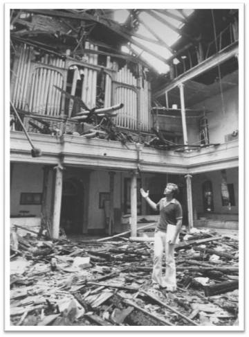 Stephen Facey assesses the damage. Courtesy St. Mark's Historic Landmark Fund