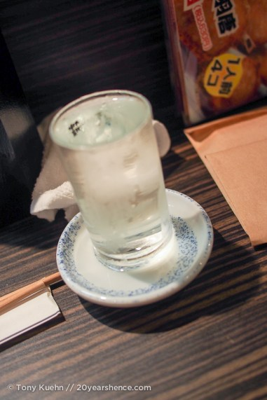 An overflowing glass of sake, overflowing to show generosity. It is polite (and expected) that you also drink the sake in the saucer