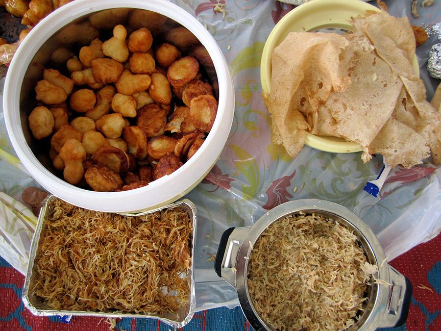 "UAE food from a school potluck. Clockwise: Luqaimat - Emirati ""donut holes"" / Khobuz Raqaq - a very thin bread / Balaleet - sweet noodles"