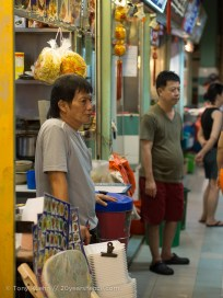 Manning a hawker stall