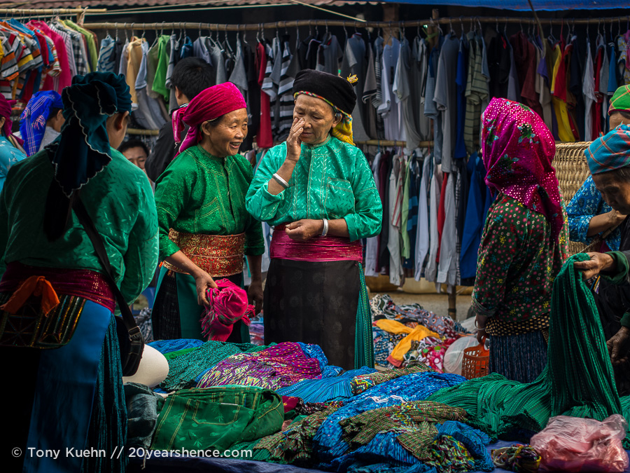 Minority ladies in colorful outfits at Dong Van market