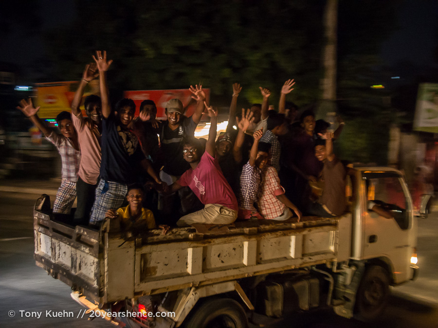 A dumptruck-full of happy Sri Lankans