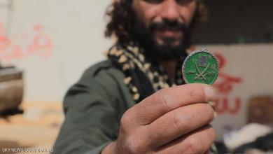 شعار للإخوان بمقر للقاعدة بليبيا