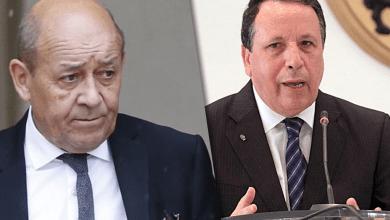 وزير الخارجية التونسي خميس الجهيناويو ووزير الخارجية الفرنسي جان إيف لودريان