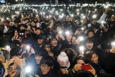 People attend a ceremony to celebrate the new year in Seoul