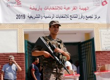 An army soldier stands outside a sports hall where ballot boxes and election material are collected to be distributed to polling stations, ahead of Sunday's presidential election in Tunis