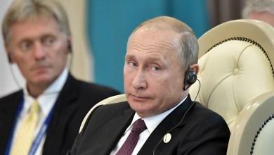 فلاديمير بوتين وديمتري بيسكوف- إرشيفية